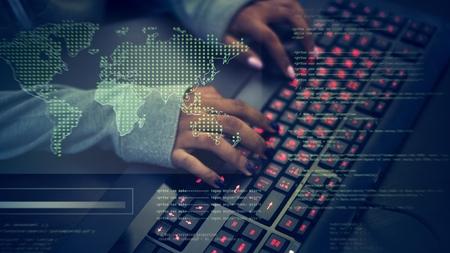 Closeup of hands working on computer keyboard Imagens