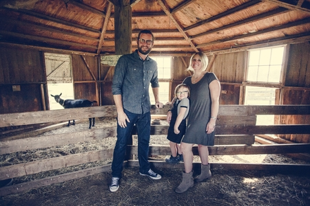 A Caucasian family is spending time at the farm together