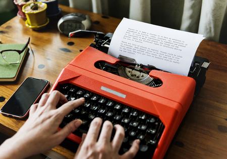 Person using a typewriter