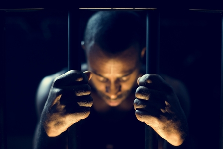African descent man in prison Stockfoto