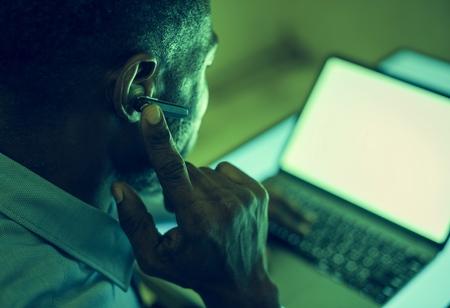 A man using bluetooth earphone device to communicate Stock Photo