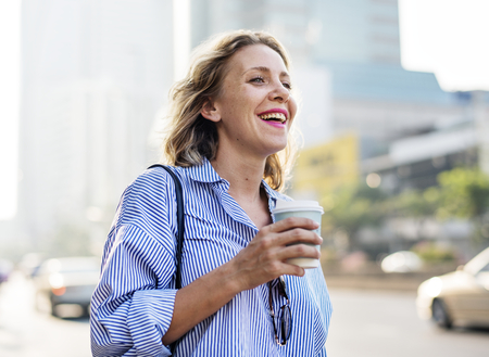 Woman on the go with take away coffee