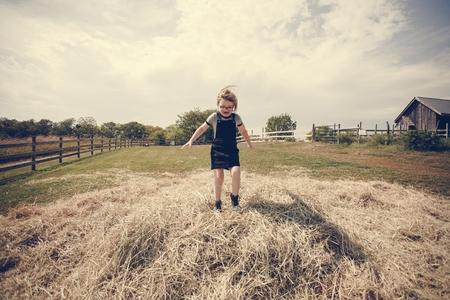 Little girl having fun in a farm Stock Photo - 100100827