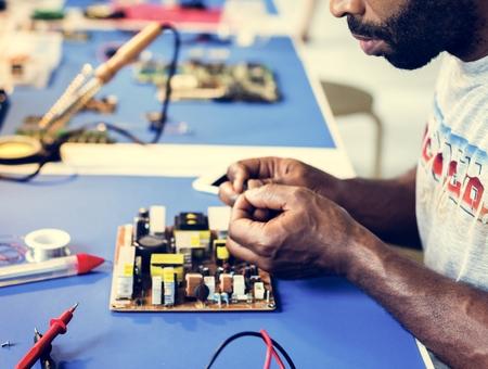 Electrical technician working on electronic board Stock fotó