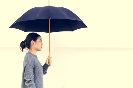 Side view of asian woman with umbrella