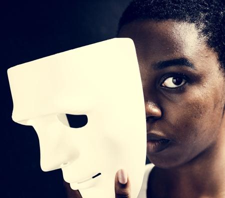 Black woman holding white mask Reklamní fotografie