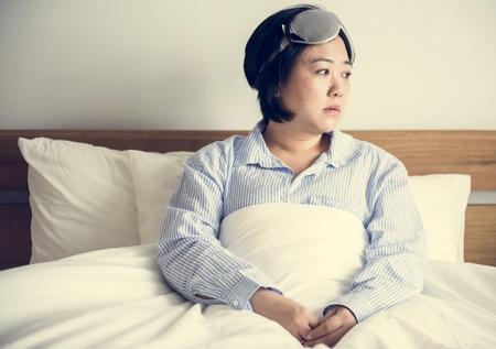 A woman waking up Stock Photo