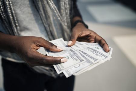 Hands holding a dollar bills Stock Photo
