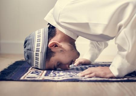 Muslim boy praying in Sujud posture Stock Photo