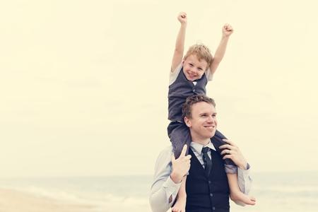 Cheerful family at beach wedding ceremony Stock fotó