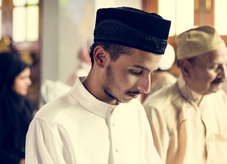 Muslim praying in Qiyaam posture Stock Photo