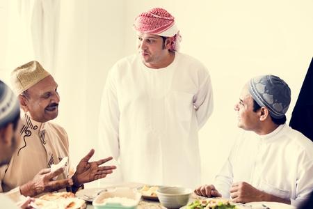 Muslim men having a meal Stock Photo