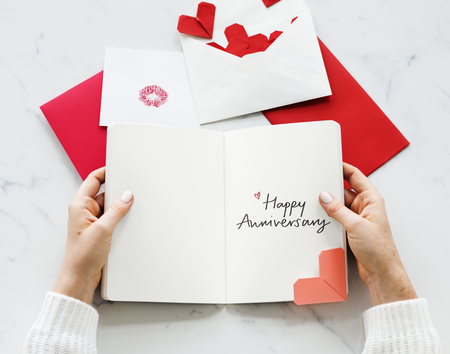 Woman holding a Happy Anniversary card