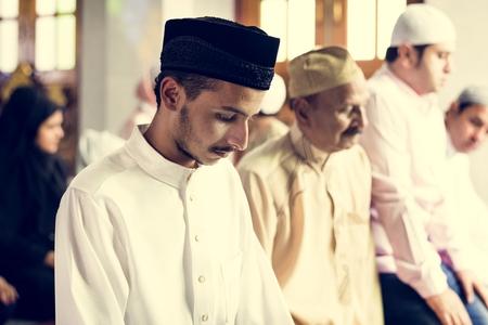 Muslim prayers in Tashahhud posture Stock Photo - 102862644