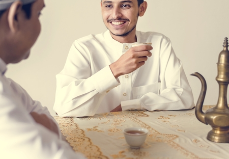 Muslim men having a cup of tea