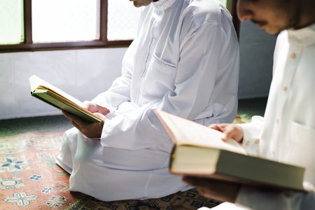 Muslims reading from the quran Stock Photo - 102862857