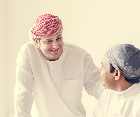 Muslim friends greeting each other Stock Photo