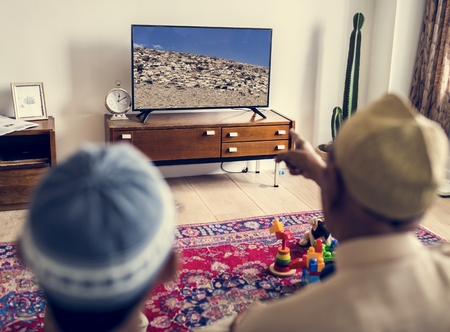Muslim family relaxing in the home Stock Photo - 102863109