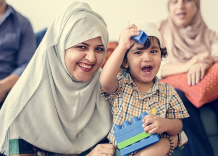 Muslim family relaxing and playing at home Stock Photo - 102861130