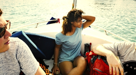 Friends traveling by boat on the sea