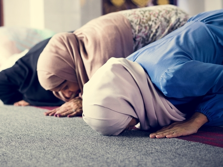 Muslim praying in Sujud posture Stock Photo