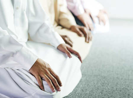 Muslim praying in Tashahhud posture