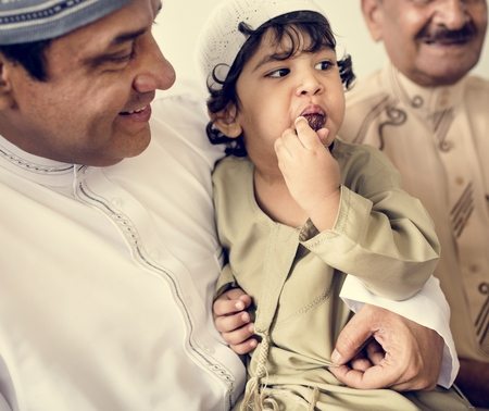 Muslim little boy with his family Stock Photo - 102863199