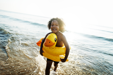 Cute toddler with duck tube on the beach Stock Photo
