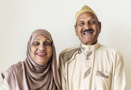 Senior Muslim couple at home Stockfoto