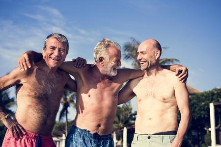Group of senior men on the beach