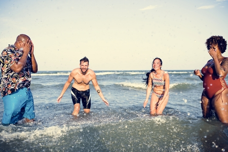 Diverse friends having fun at the beach