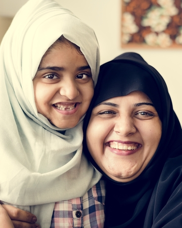 Muslim mother hugging her daughter with love