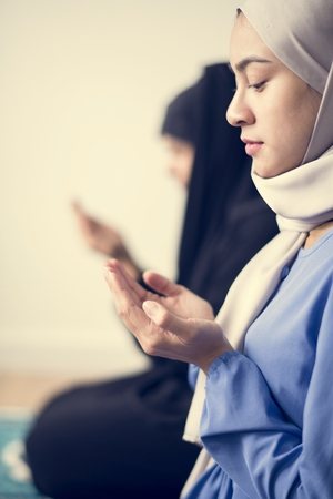 Muslim women making Dua to Allah Stock Photo
