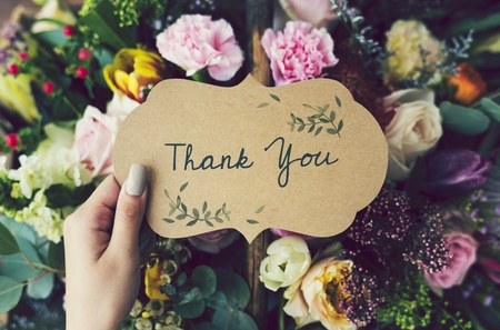 Handwritten thank you card with floral background Foto de archivo