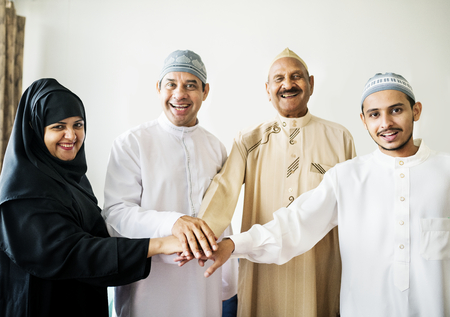 Muslim group of friends stacking hands Stock Photo - 102863528