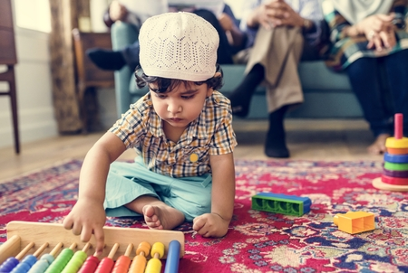 Muslim family relaxing and playing at home Stock Photo - 102863532