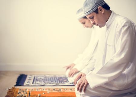 Muslim praying in Tashahhud posture Stock Photo - 102863666