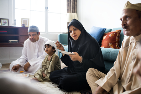 Muslim family having dinner on the floor Stock Photo - 102863571