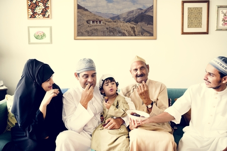 Muslim family having dried dates as a snack Stock Photo - 102863575