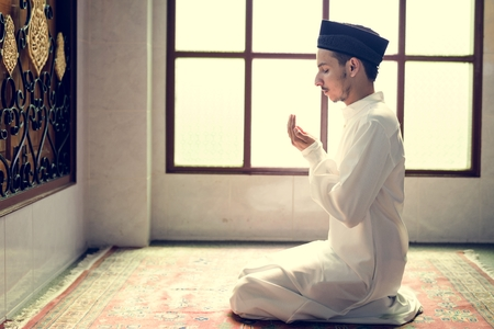Muslim man making Dua to Allah Stock Photo - 102863584