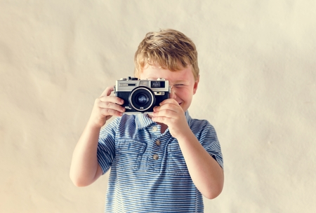 Caucasian boy playing with a camera Stock Photo