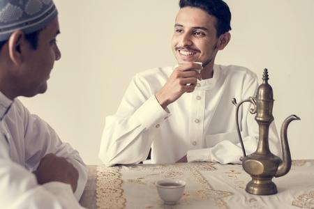 Muslim men having a cup of tea Stock Photo - 102863622