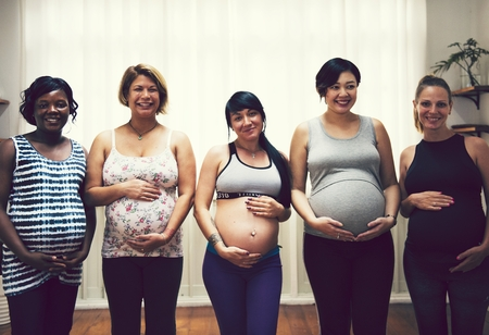 Women at a pregnancy yoga class