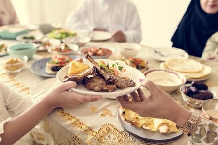 Muslim family having a Ramadan feast Stok Fotoğraf - 102863744