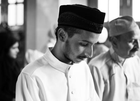 Muslim people praying in Qiyaam posture Stock Photo - 102863777