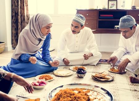 Muslim family having dinner on the floor Stock Photo - 102863821