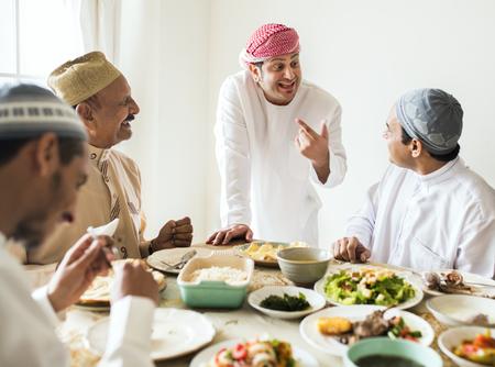 Muslim men celebrating ending of Ramadan Stock Photo