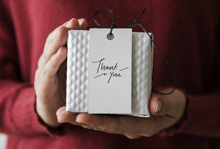 Woman holding a Thank You present