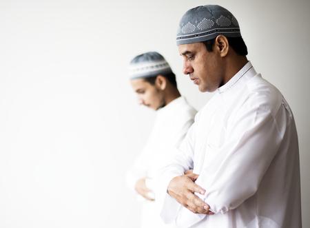 Muslim men praying during Ramadan Stock Photo