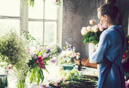 Woman working as a florist Stok Fotoğraf - 102863905